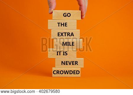 Go The Extra Mile Symbol. Wooden Blocks With Words 'go The Extra Mile It Is Never Crowded'. Male Han