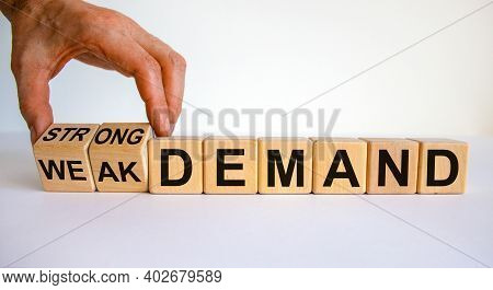 Strong Or Weak Demand Symbol. Businessman Hand Turns Cubes And Changes Words 'weak Demand' To 'stron
