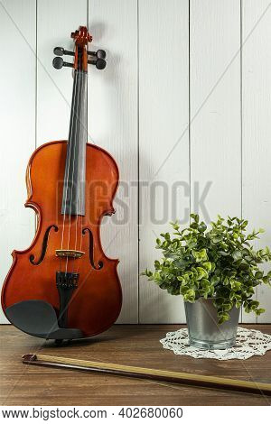 A Violin Instrument On A Wooden Table