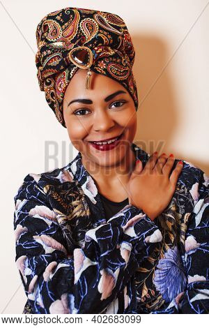 Beauty Bright African Woman With Creative Make Up, Shawl On Head Like Cubian Closeup Smiling