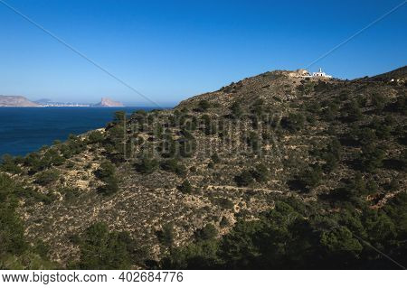 Sunny Natural Park Serra Gelada With Lighthouse And The Rock Ifach Of Calpe In The Background, Albir