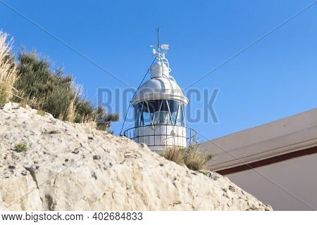 Tower Of Whitewashed Lighthouse Keeping A Smal Museum In The Natural Park Serra Gelada In Albir, Cos