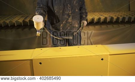 Heavy Industry Concept, Industrial Professional Spray Painting Of Metal Parts. Clip. Male Worker In