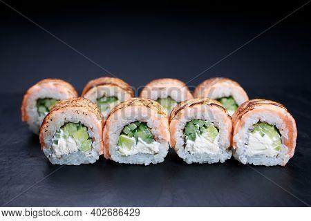 Grilled Salmon Sushi Rolls Served On Slate, Food Background. Japanese Restaurant Menu Photo, Seafood
