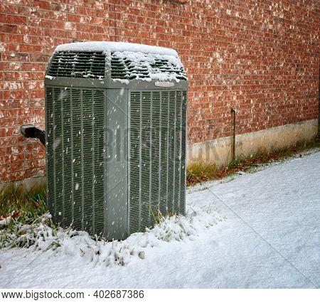 Modern High Efficiency Air Conditioner Under Falling Snow