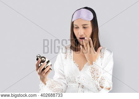 Woman In A White Satin Nightgown And Wearing Lace Robe Waking Up Late In The Morning Turning Holding