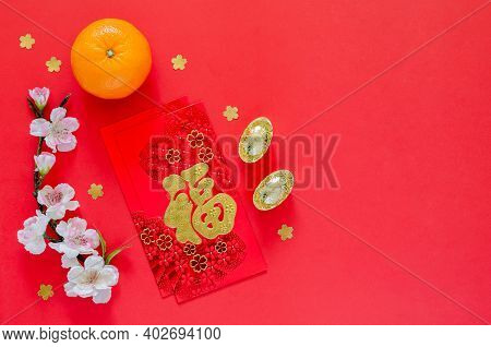 Red Envelope Packets Or Ang Bao (word Means Wealth) With Gold Ingots, Orange And Chinese Blossom Flo