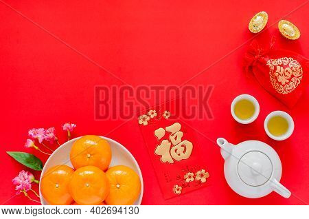 Chinese New Year Red Background With Gold Ingots, Red Bag (word Mean Wealth), Tea Set, Red Envelope