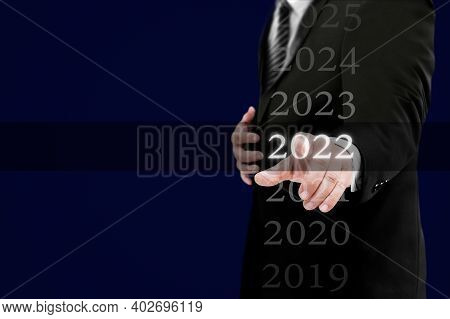 Business New Year Card 2022 Concept: Businessman Welcome Year 2022