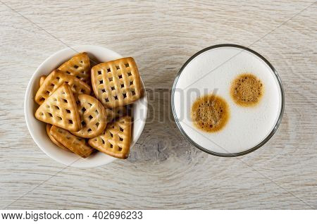 White Bowl With Cookies Triangular, Square And Round Shape, Glass With Latte-macchiato On Wooden Tab