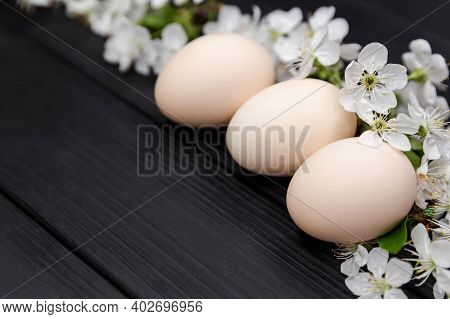 Happy Easter Concept With White Spring Flowers. Natural Floral Spring Decorations. Uncolored Natural