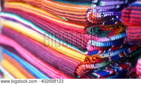 Colorful Mexican Wool Serape Blankets Texture. Woven Ornamental Vivid Textile With Authentic Latin A