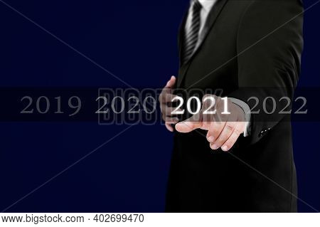 Business New Year Card 2021 Concept: Businessman Welcome Year 2021