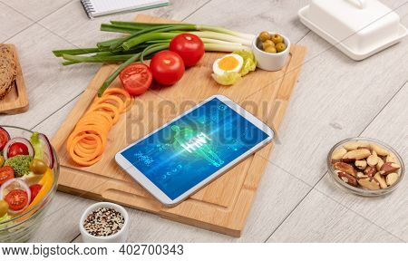 H1N1 concept in tablet with fruits, top view
