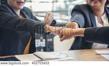Group Of Diversity People Fist Bump Holding Hands Together Power Of Tag Team. Teamwork Multiethnic P