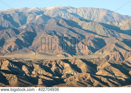 Arid Mountainous Terrain During Sunset Creating Natural Shadows On The Landscape Taken In Mt San Gor