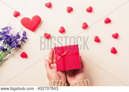 Valentine's Day And Birthday. Woman Hands Holding Gift Or Present Box Decorated And Red Heart Surpri