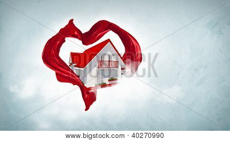 House withing a red heart symbol from fabrique