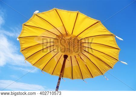 Traditional Yellow Beach Umbrella Or Parasol Or Sunshade In Lombok