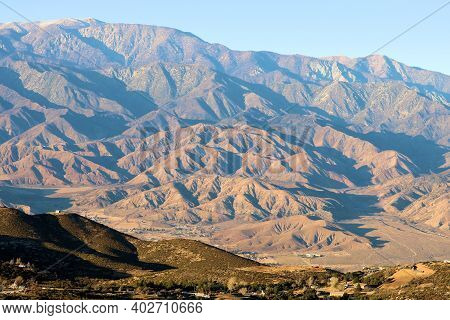 Sun Setting On Arid Mountains Creating Natural Shadows Taken On Rural Badlands At The Southern Calif