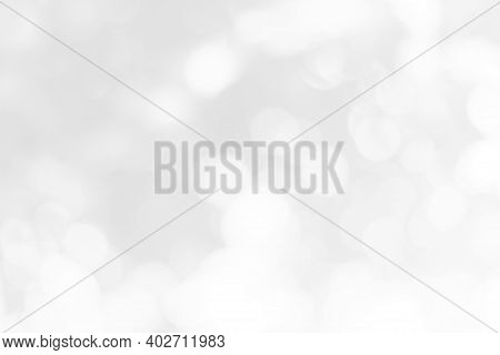 Abstract Background With Bokeh Effect. Blurred Defocused Lights In White Colors, White Blur Abstract