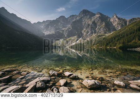 Tatra National Park, Poland. Famous Mountains Lake Morskie Oko Or Sea Eye Lake In Summer Morning Sun