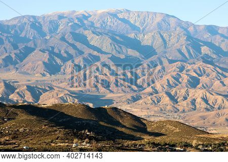 Sun Setting On Arid Badlands Terrain Creating Natural Shadows With Mt San Gorgonio Beyond Taken In T
