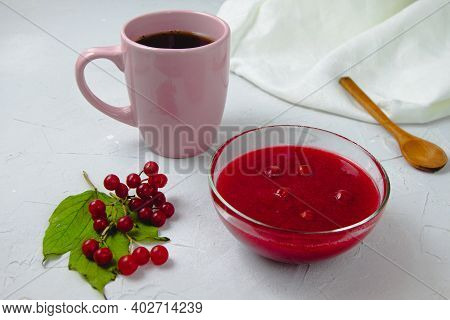 An Autumn Composition With Viburnum Jam, Viburnum Branches And Leaves, White Linen Towel, Pink Cup,
