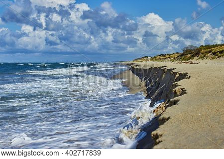 Foamy Surf Waves And Beautiful Cloudy Sky