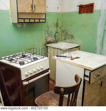 Interior Of An Old Dirty Kitchen. Preparing For Repairs