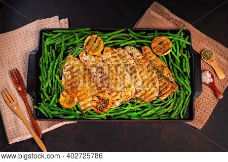 Grilled Chicken Breast With , Herbs, Cut Lemon.