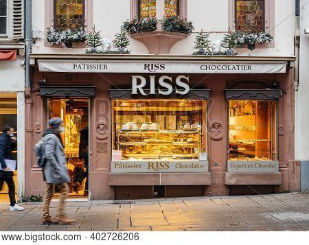 Strasbourg, France - Jan 7, 2021: Pedestrians People Walking In Front Of Ross Patissier Chocolatier