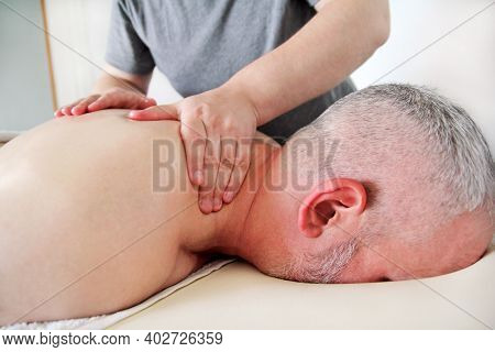 Massage Relax Professional Studio. Spa Treatment. Man Relaxing Comfort Getting Neck, Shoulder And Ba