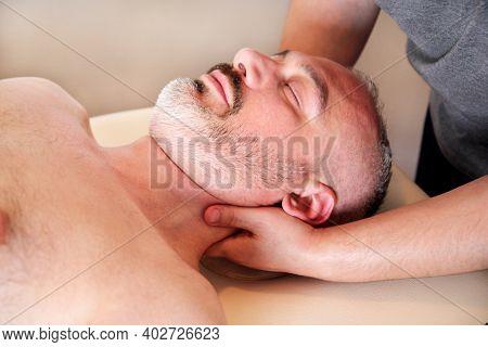 Massage Relax Professional Wellness Center. Masseuse Human Hands Massaging For Neck. Man Taking A Ma