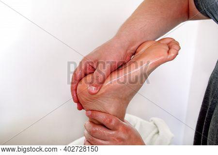 Foot Massage In Beauty Salon, Close Up View. Woman Having Sports Foot Massage In Spa Salon. Male Mas