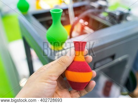hand with vase closeup object printed 3d printer close-up. Progressive modern additive technology 4.0 industrial revolution