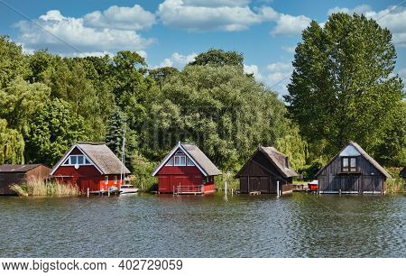 Idyllic Landscape With Wooden Boathouses In Mueritz National Park, Mecklenburg Lake District,germany