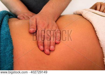 Belly Massage In Massage Studio. Close Up Of Hands Massaging Female Abdomen. Masseur Massaging Girls