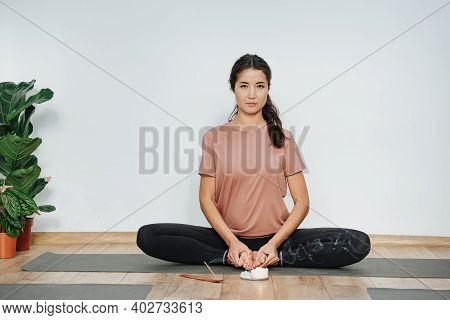 Smug Woman Practicing Yoga, Doing Butterfly Asana, Turnig Soles Upward