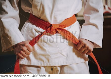 A Man Stands In A Karate Stand And Looks At The Camera. A Bald Man In A Kimono Stands In A Stance Wi