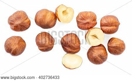 Full And Halfs Of Hazelnuts Isolated On White Background. Hazelnut Macro.  High Resolution Image.