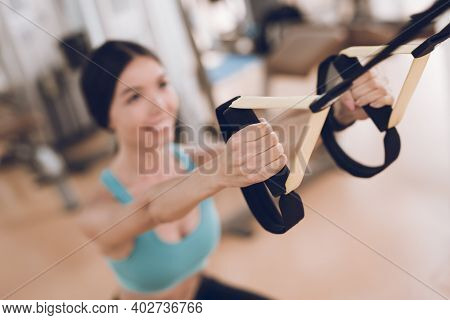 The Girl Does Exercises On Uneven Bars.