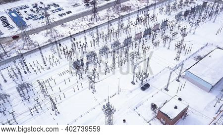 Top View Of Electric City Substation. Action. Electrical Substation With Transformers Distributing H