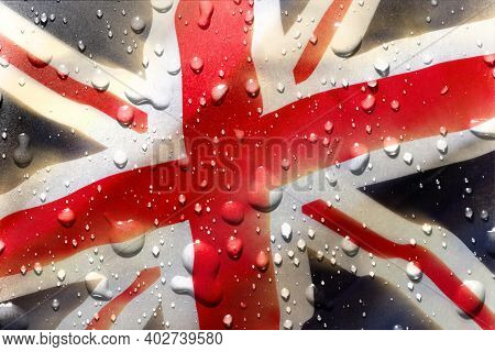 Water Drops On A Union Jack Flag. United Kingdom National Patriotic Symbol Adopted In 1801