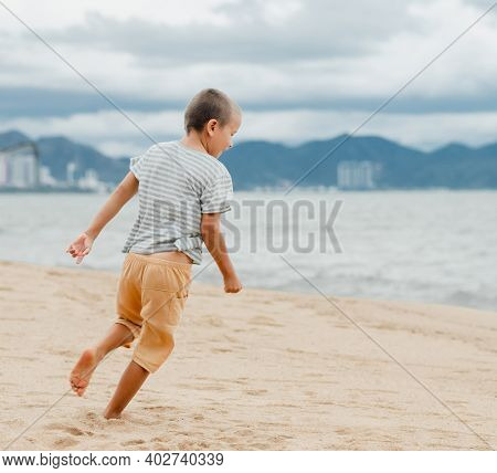 Outdoor portrait of a little cute boy running