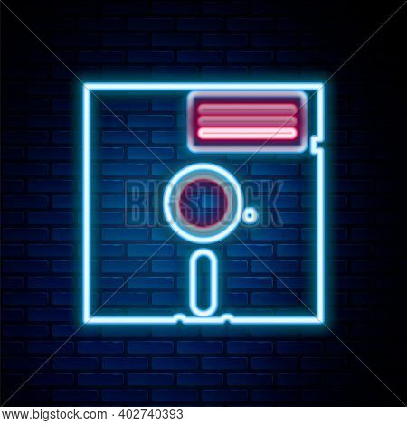 Glowing Neon Line Floppy Disk In The 5.25-inch Icon Isolated On Brick Wall Background. Floppy Disk F