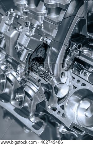 Cut section of automotive engine in monochrome