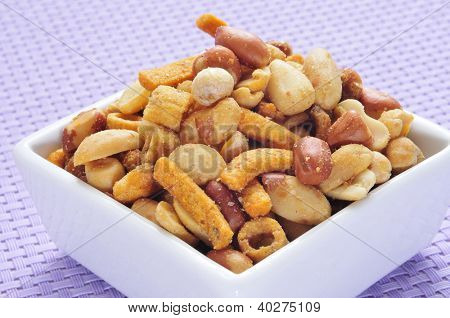 a bowl with salted and roasted mixed nuts, as peanuts, corn seeds, chickpeas and sunflower seeds poster