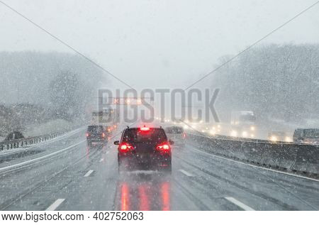 Highway With Cars In Winter With Snow Fall In Great Britain