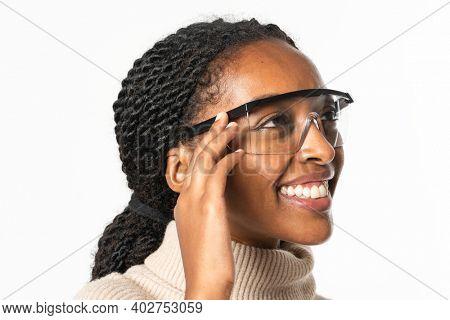Businesswoman wearing AR glasses, AR smart glasses, smart glasses  futuristic technology